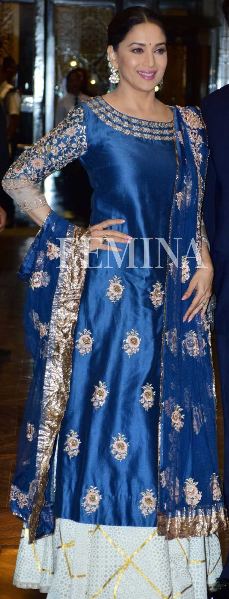 ANJU MODI We love the shade of cloudy blue on this Anju Modi sharara. A neat middle-parted bun and jumkas kept her look clean and ensured that all the attention stayed on the voluminous outfit.