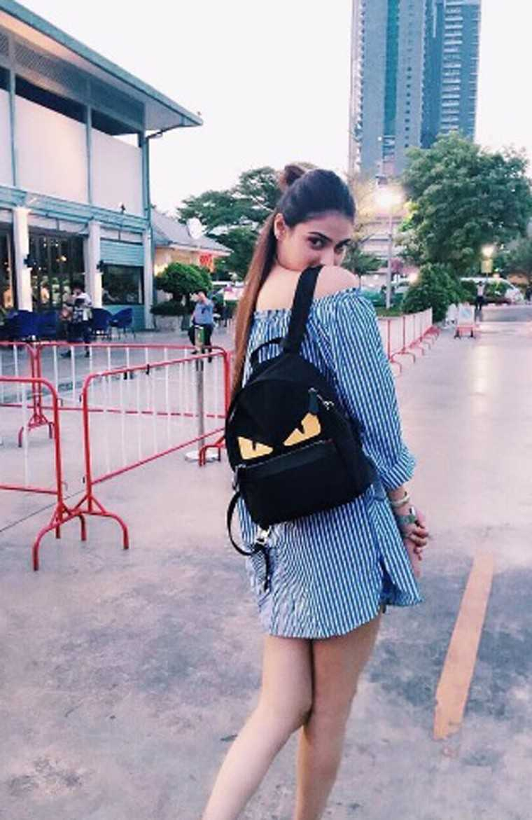 ATHIYA SHETTY Her Fendi backpack is a must-have with all the It Girls this season. Athiya paired it with a summery, off-shoulder dress that was the perfect way to offset the bag's cartoon-ish vibe.