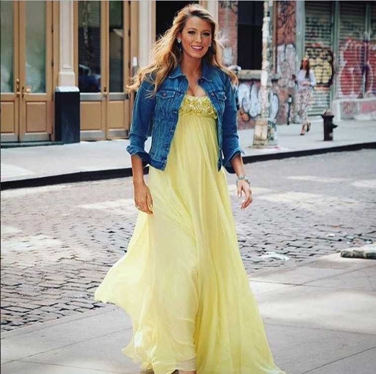 BLAKE LIVELY Gowns and denim might make an odd pairing but we love the way that Blake pairs her Madewell jacket over a buttercup yellow Jenny Packham gown.