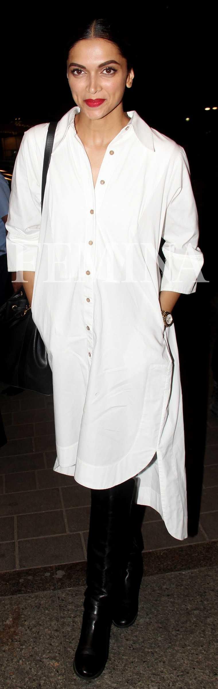 DEEPIKA PADUKONE In case you don't have one already, your next big purchase should definitely be a crisp white shirt dress like Deepika's from the Chola by Sohaya. It's the perfect canvas to channel any mood—wear it over your jeans if you're tra