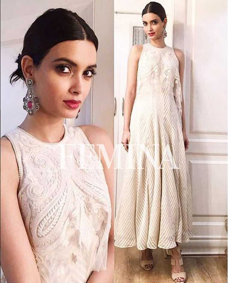 Diana Penty cuts an elegant figure in a lacy Tarun Tahiliani maxi. She keeps it simple with kohl-lined eyes, red lips and a pair of silver danglers.