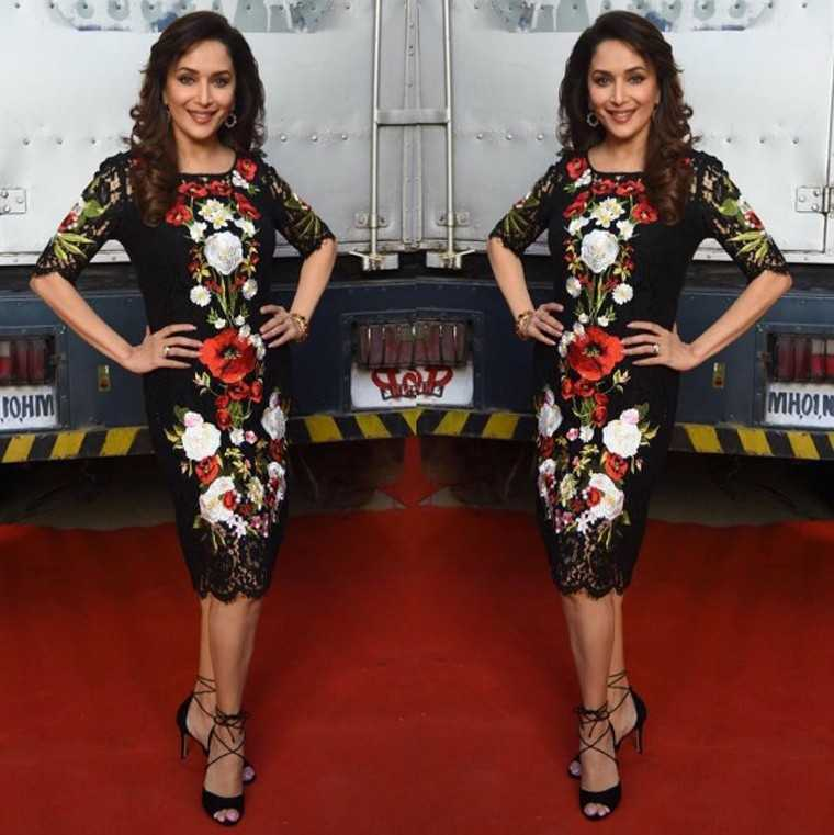 DOLCE & GABBANA Probably our favourite sighting of her so far, Madhuri works this floral Dolce & Gabbana sheath like a true Italian diva. Strappy stilettos were the only accessory the outfit needed.