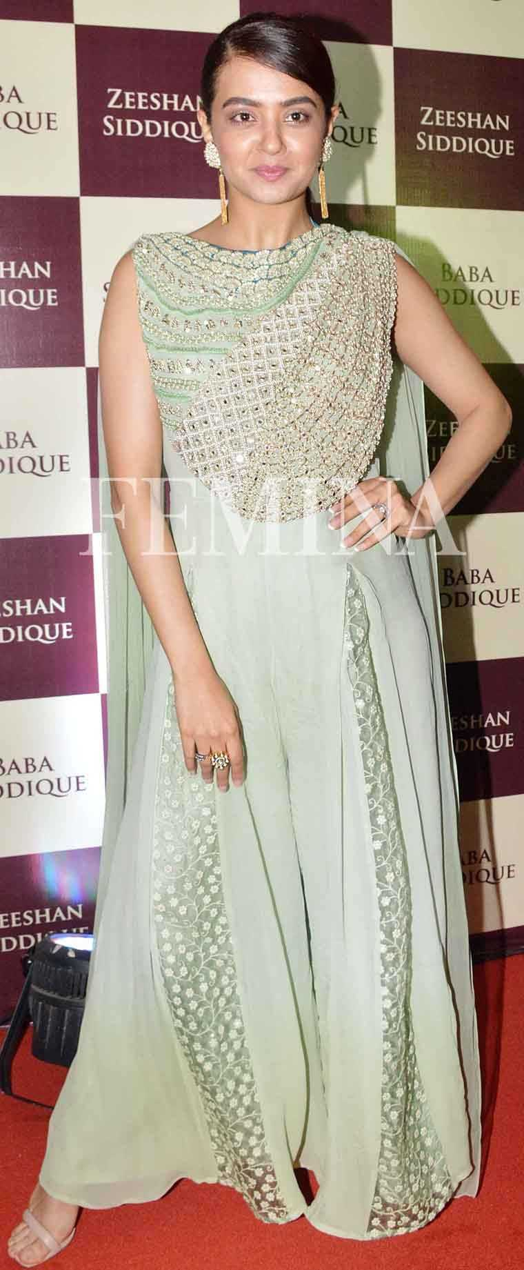 SURVEEN CHAWLA Surveen stepped out for a party in a Ridhima Bhasin jumpsuit. She chose a pair of statement earrings from Aquamarine and nude sandals to round off her look.