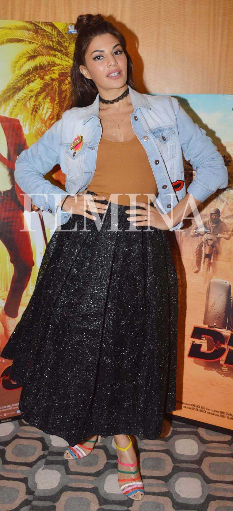 JACQUELINE FERNANDEZ For Dishoom promotions, the actor has been rocking a lot of '90s-inspired looks. Case in point this denim jacket worn over a voluminous Sameer Madan skirt, a chiker and multi-coloured strappy sandals.