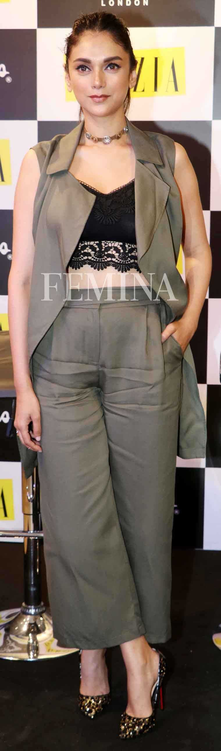ADITI RAO HYDARI A metallic Topshop choker added some shine to Aditi's safari-chic Marks & Spencer and Zara separates.
