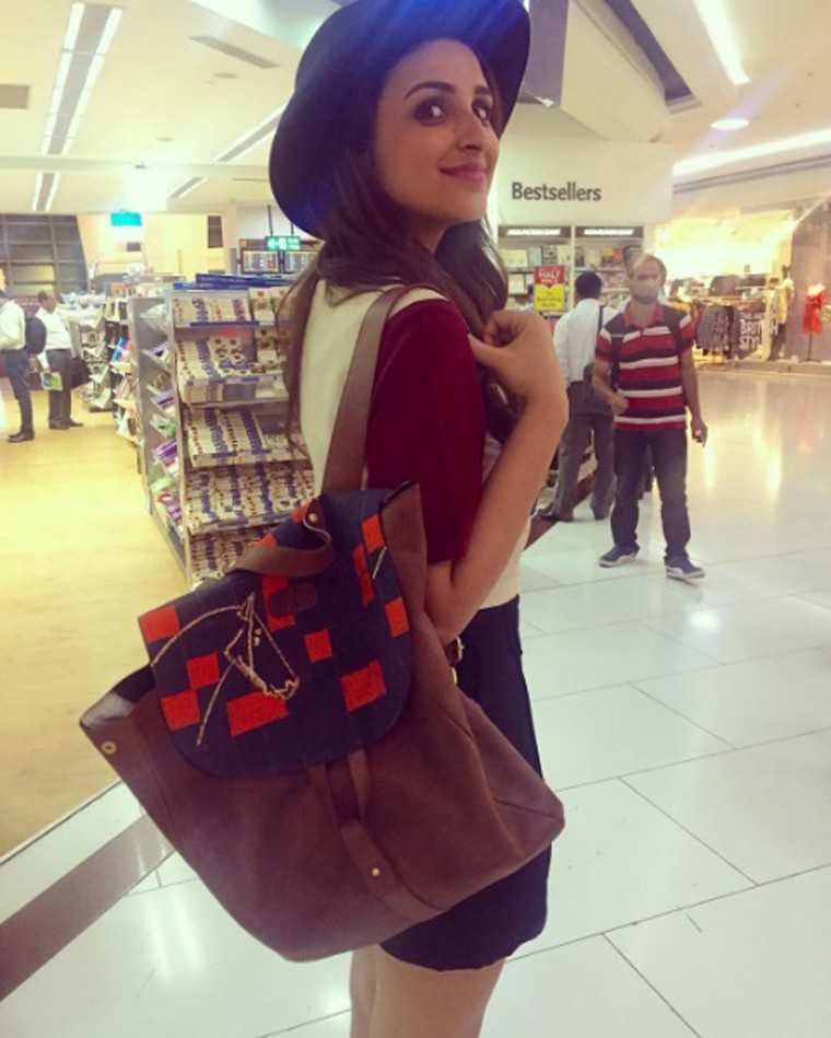 PARINEETI CHOPRA The actor was excited to show-off her own customised, slouchy Masaba backpack. With its graphic prints and soft suede fabric, this one is definitely more suitable for art school than high-school.