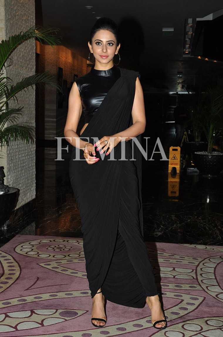 Hoops: Rakul pulled off her all black ensemble with a pair of large hoop earrings.