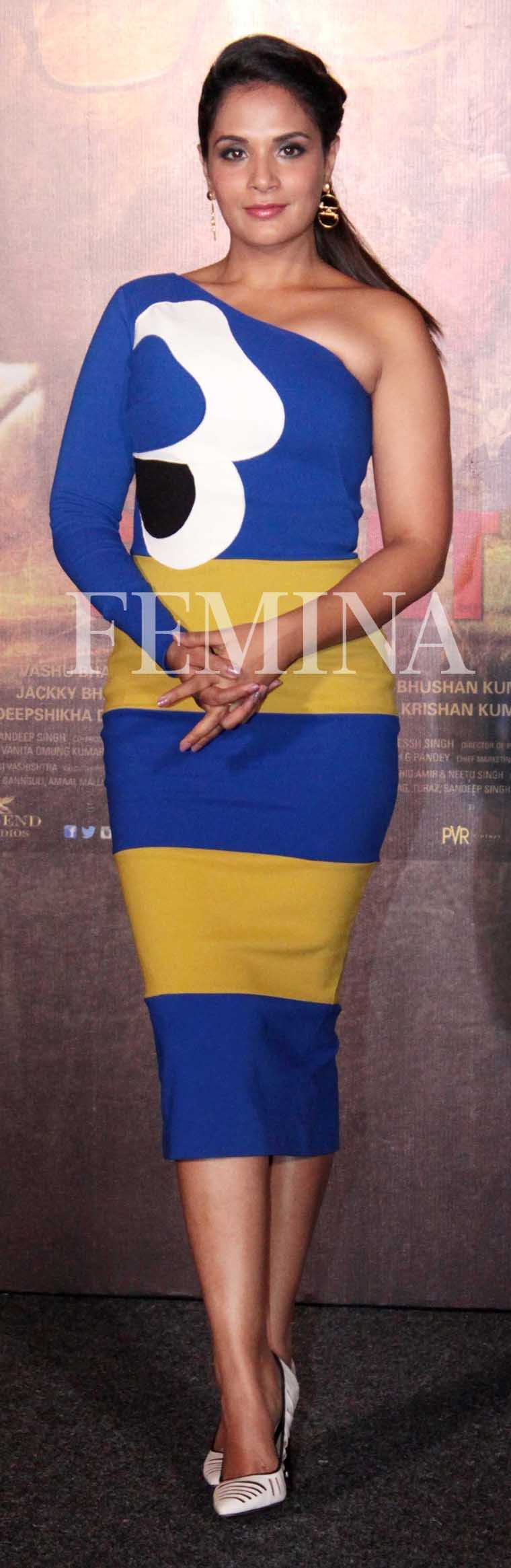 RICHA CHADHA: Stripes, bold florals, an electric blue sleeve—this striking Gauri and Nainika number ticks all the trend boxes. Richa wore the form-fitting printed dress with aplomb and paired it with white Gwen Stefani pumps.