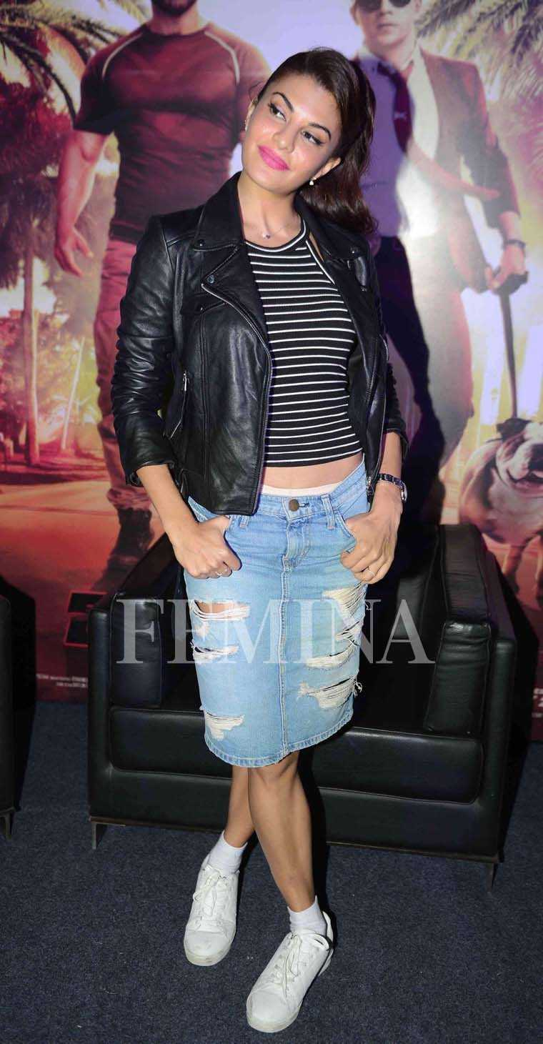 Jacqueline Fernandez has been giving us a lot of '90s inspired looks. Here she wears a halter crop top with a ripped denim skirt and a leather jacket.