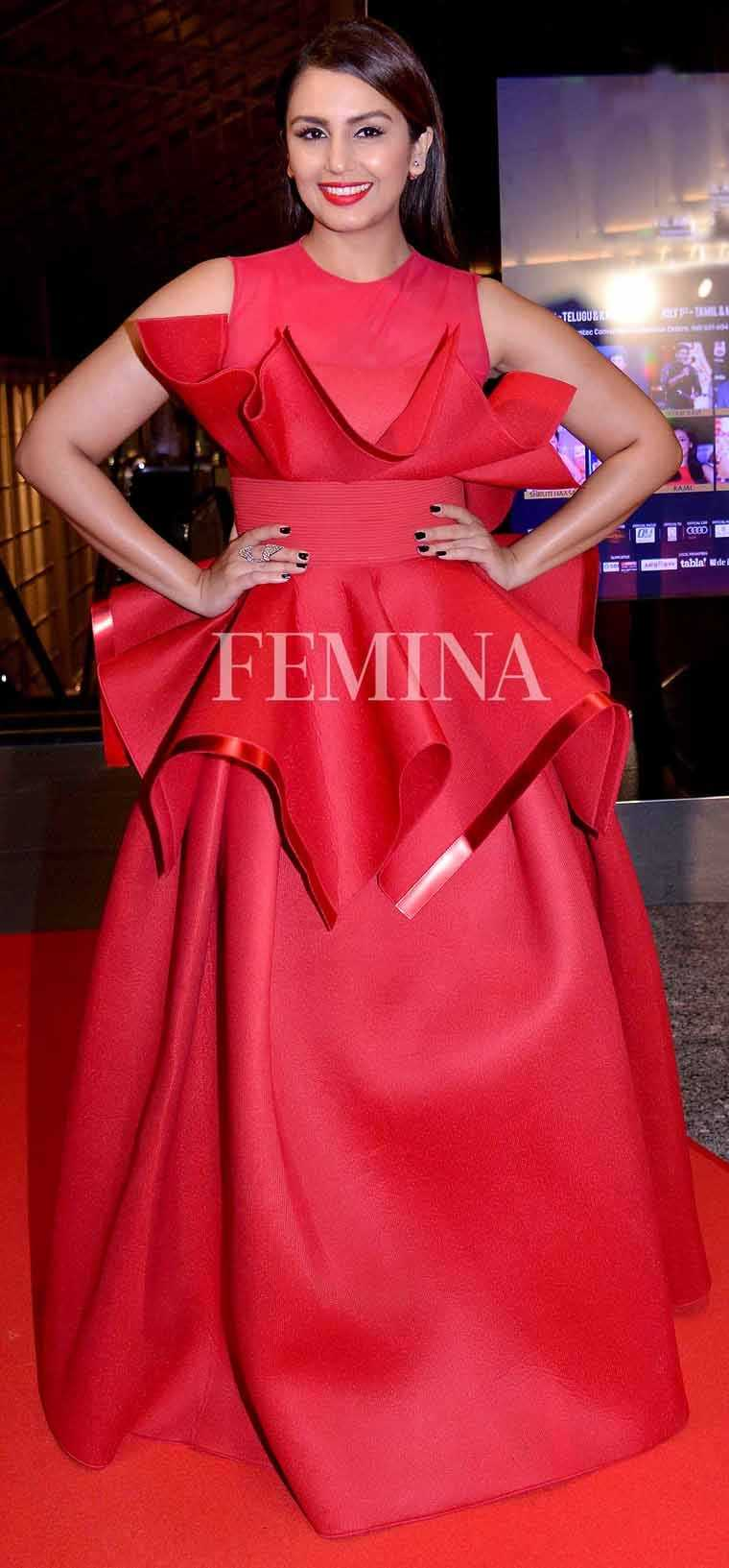 Huma stepped out for an event in a voluminous Amit Aggarwal gown. She paired her red hot number with minimal accessories and a sleek hairdo.