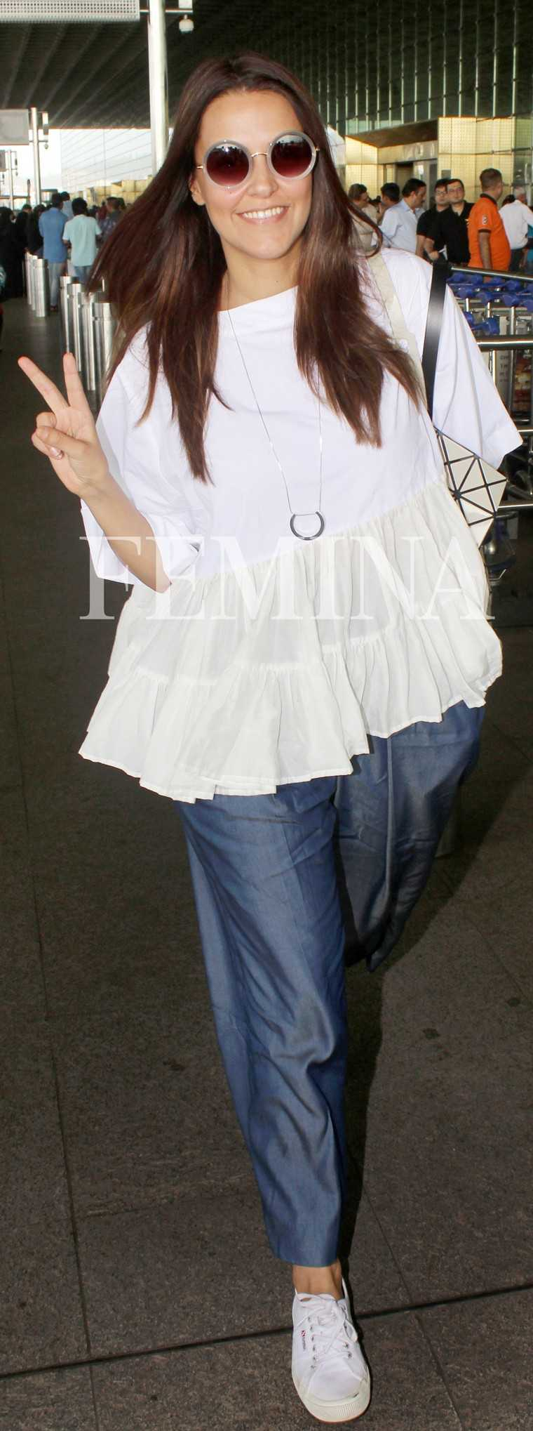 Neha Dupia: Neha rocked her travel gear in flared trousers, classic white sneakers and a matching loose blouse. The geometric tote made for her statement accessory.
