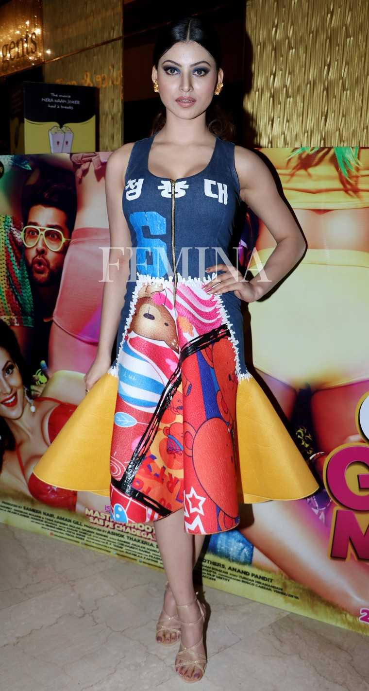 Bollywood actor Urvashi attended a trailer launch in a sporty number. She went for a bold-coloured structured dress and paired it with bright orange earrings and navy eye shadow.
