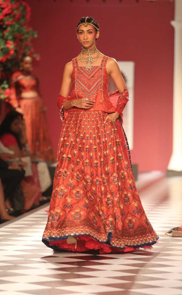 vermillion-hued sari or lehenga