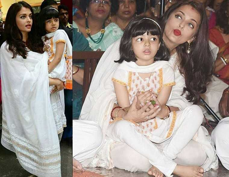 Cuties Aishwarya Rai Bachchan and Aradhya Bachchan took part in the festivities dressed in off-white salwaar-kameez-dupattas. Aradhya's mini version had accents of orange.