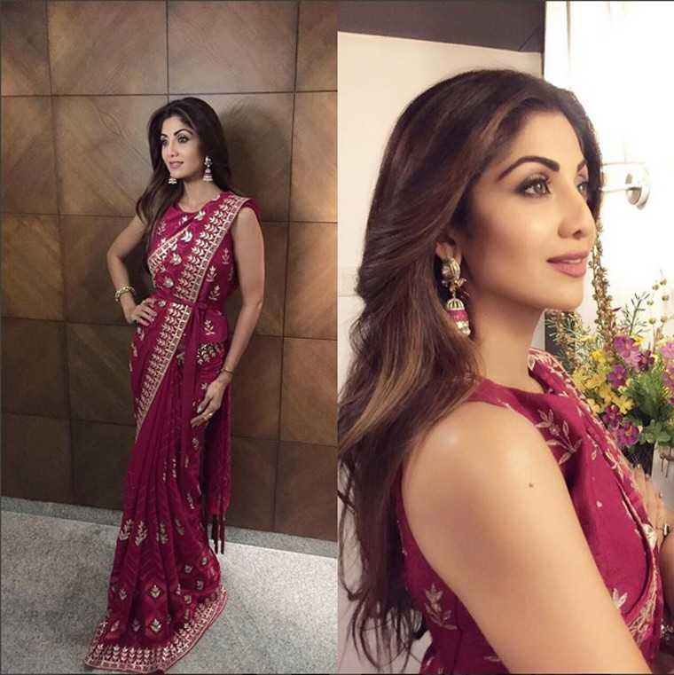 Shilpa Shetty showed off her enviable figure in an embellished sari-blouse combo by Anita Dongre. She added a touch of sparkle with a pair of ornate jhumkis.