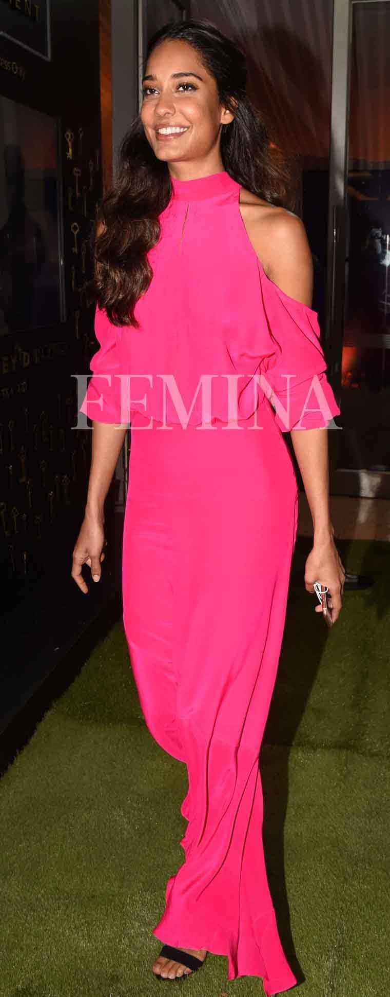 Lisa Haydon does festive dressing with a difference in a flowy hot pink maxi by Atsu.