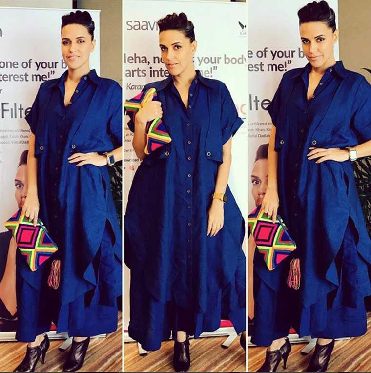 Neha Dhupia promoted her upcoming show dressed in a royal blue outfit from her favourite label, Chola by Sohaya Mishra. She accessorised with leather booties and a patterned clutch