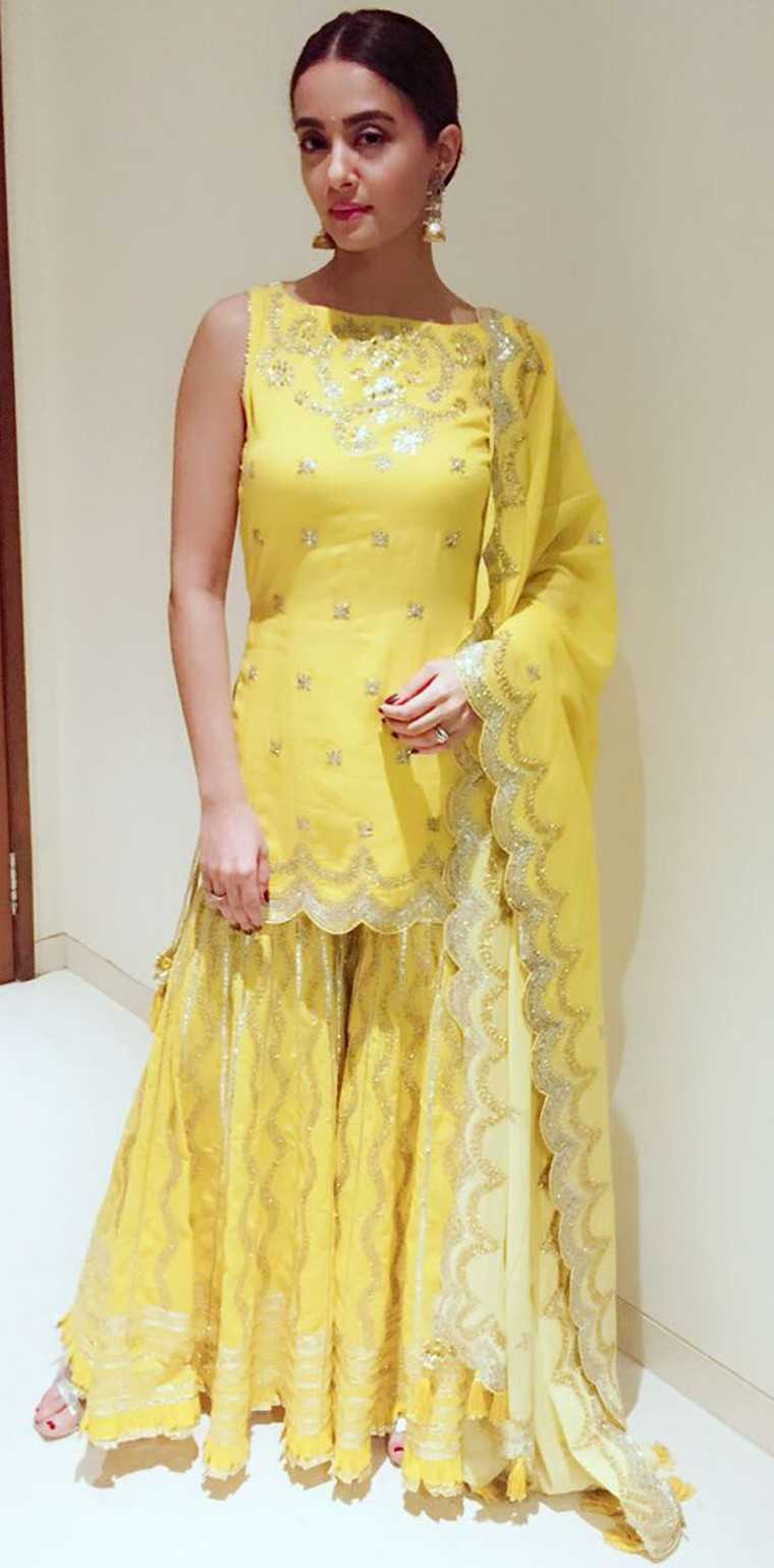 Surveen Chawla who has risen to popularity with TV show 24 stepped out in a bright yellow sharara set by Sukriti & Aakriti