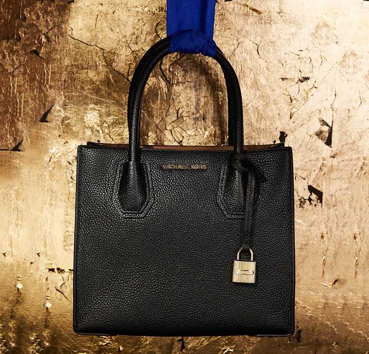 Crafted from bonded leather, this black tote is an absolute dream come true. With space enough for your keys, tablet, wallet and everything else you deem indispensable, this tote will work perfectly with your formal outfits.