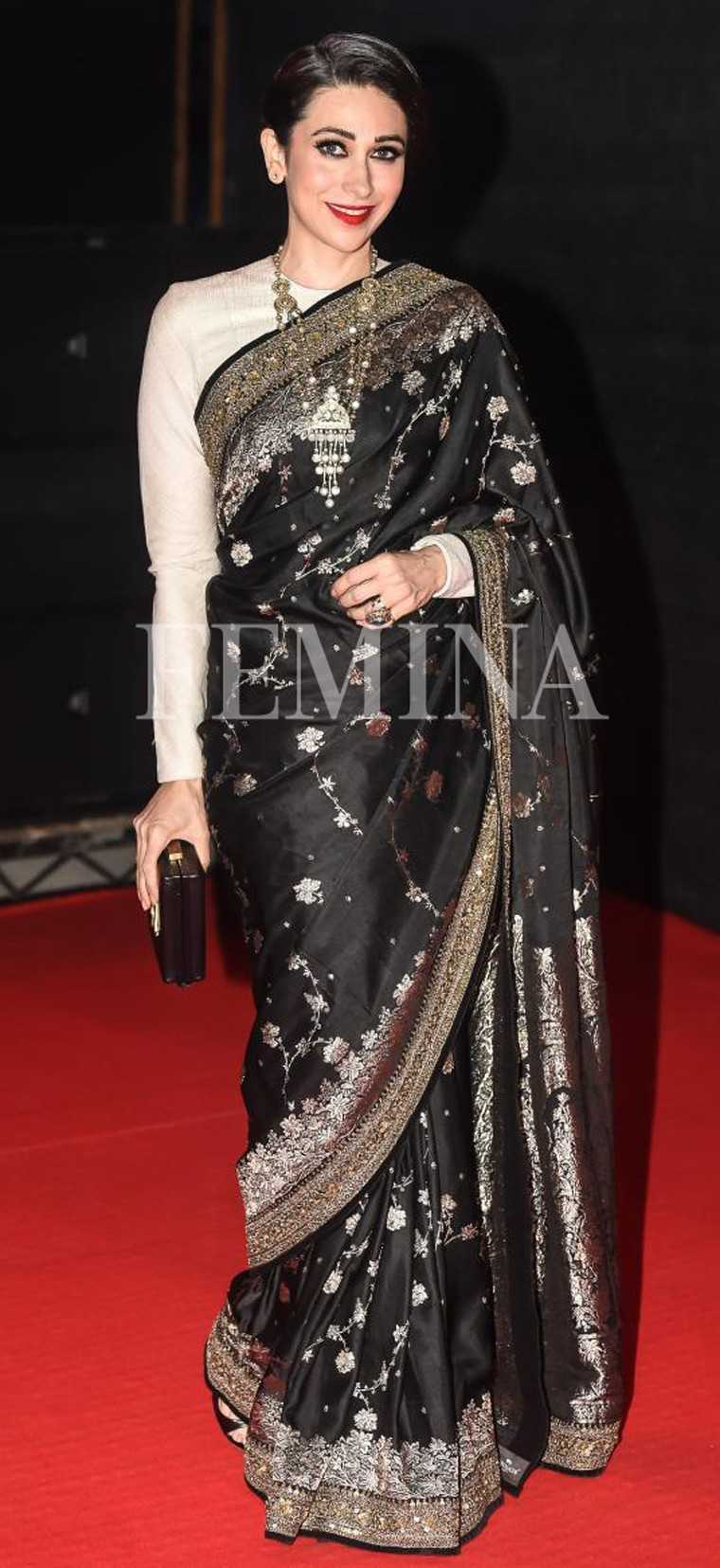 Karisma paired her black and gold Sabyasachi sari with a full-sleeved high neck white blouse. Gold jewellery from Amrapali added a regal finish.