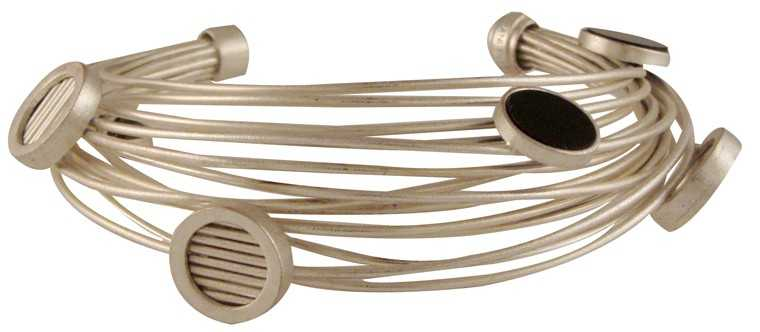 Trade your run-of-the-mill jewellery for this statement cuff.  Silver plated copper and black Perspex wire cuff, Rs 7,500, Suhani Pittie