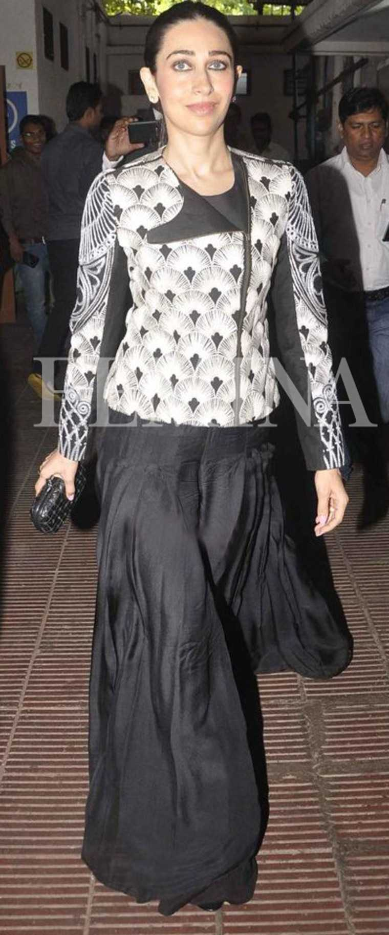 Karisma paired her sculptural Nachiket Barve jacket and wide leg trouser combo with a Bottega Veneta knot clutch.