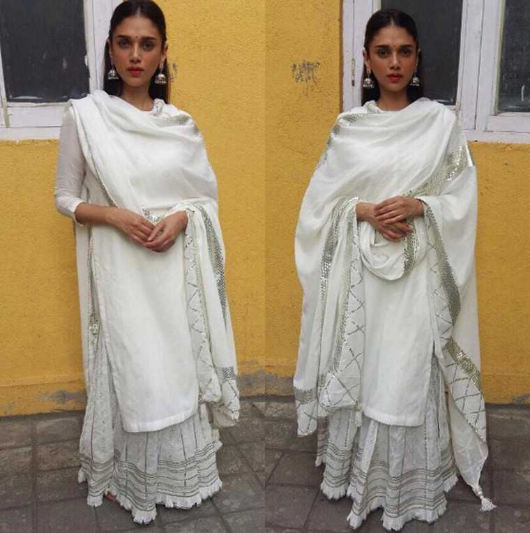ADITI RAO HYDARI: There's nothing like a pristine white outfit to make you feel fresh and summery. Here Aditi wears her Sukriti and Akriti kurta over an embroidered lehenga with matching silver jewellery.