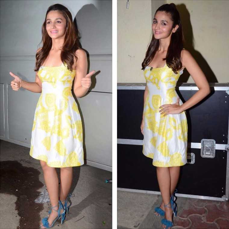 Forget matching your shoes to your outfit, instead Alia opted for bright blue Aquazzura heels to go with her lemon-yellow Prabal Gurung dress.
