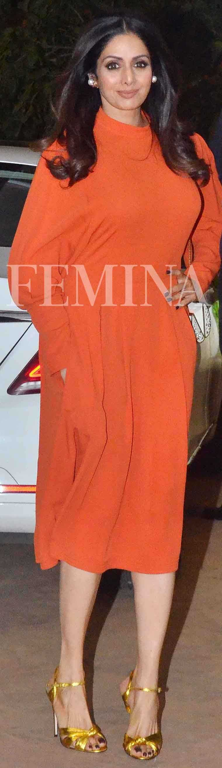 Sridevi is a surprise entry into our list this week looking pretty darn good in her tangerine midi dressed paired with gold stilettoes.