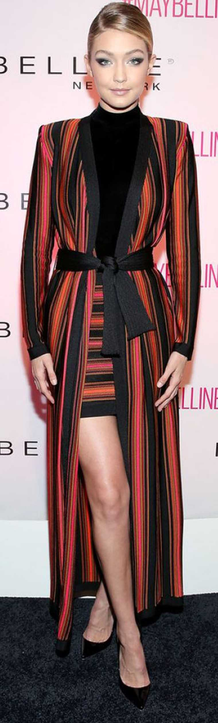 GIGI HADID: Girl of the moment Gigi Hadid worked a Balmain mini skirt and jacket combo that featured stripes in similar tones of orange, red, rust and pink offset by a black inner.