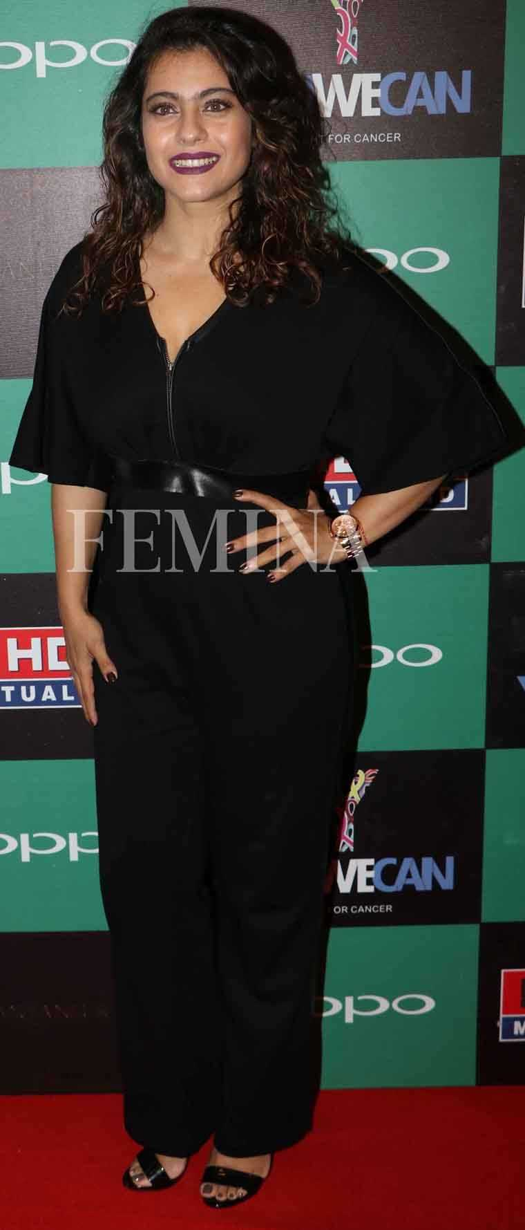KAJOL: A sleek black jumpsuit is a chic alternative to your LBD. Dress it up with some big baubles or do like Kajol and add a bold lip colour instead.