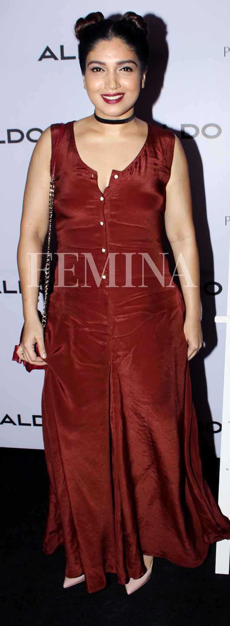 BHUMI PEDNEKAR: Velvet is a hot trend of the season and we love how Bhumi works it by paring her velvet Cord jumpsuit with Minnie Mouse-style buns and a choker neckpiece.