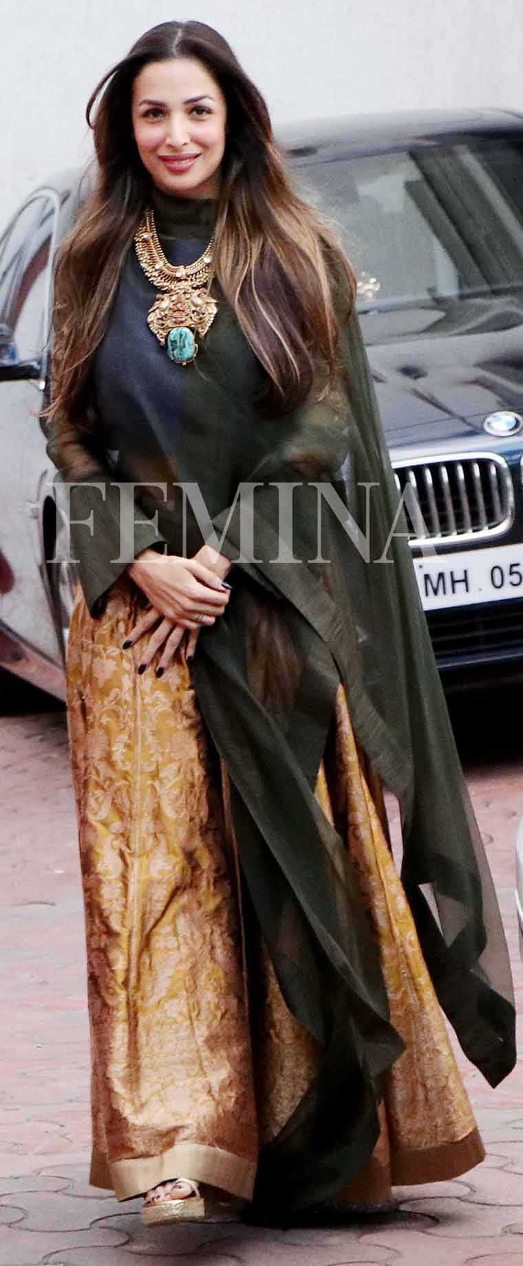 MALAIKA ARORA KHAN: Designer Payal Khandwala's festive collection was a fusion of feminine lehengas in brocade with mannish tailoring—here Malaika wears a shirt-style, high-collared top over her gold skirt.