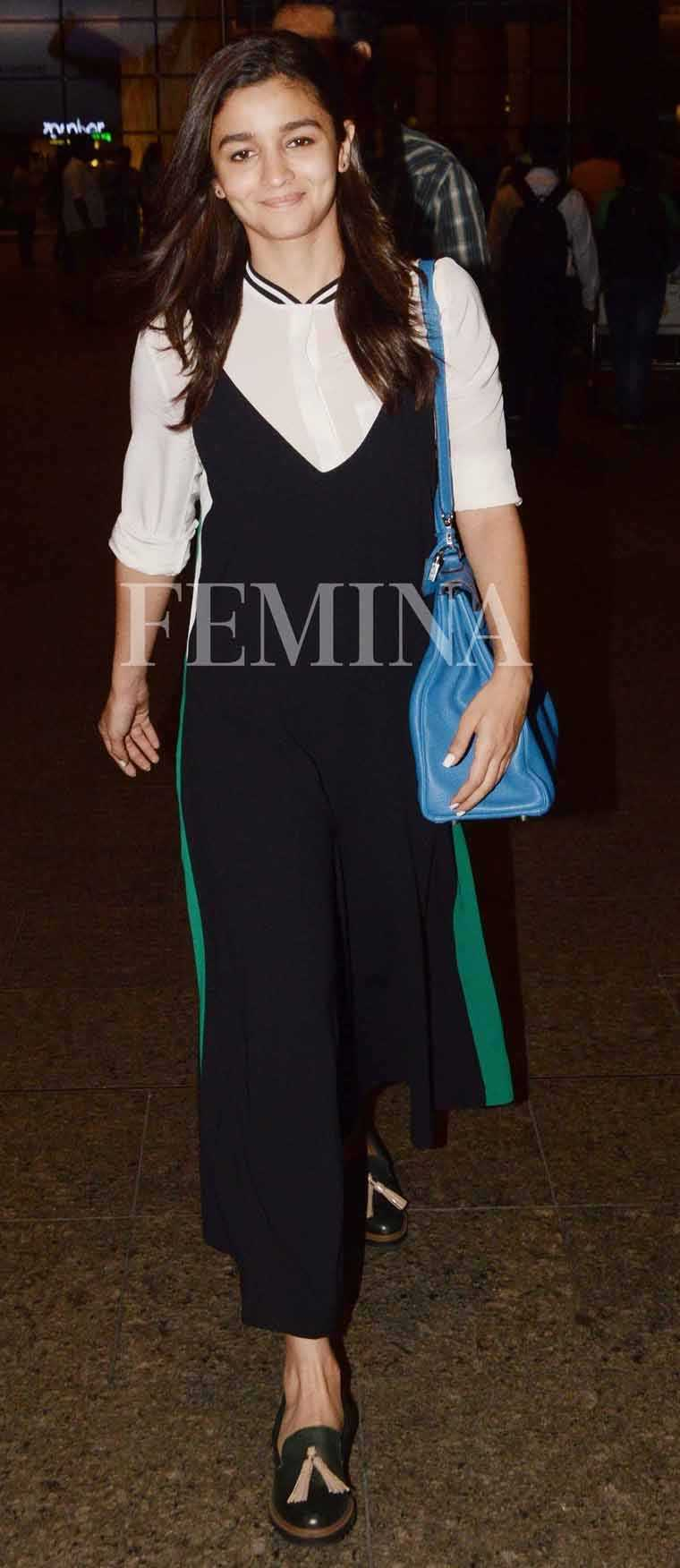 Alia Bhatt aced travel dressing in a Madison jumpsuit layered over a Uterqüe blouse. She adds a pop of colour with her Hermès Kelly.