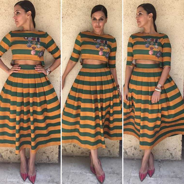 NEHA DHUPIA: Neha rocked this bold Pankaj & Nidhi number in army green and mustard tiers. Her pulled-back hair and the red stilettos perfectly off-set what would have otherwise been an overwhelming look.