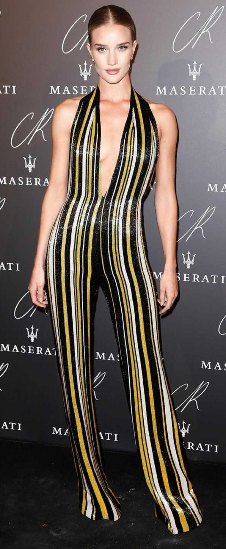 ROSIE HUNTINGTON-WHITELEY: It doesn't take much for this supermodel to look good. A glowing, fresh-faced make-up look and a body-hugging Balmain jumpsuit with honeybee-coloured vertical stripes that show of her height are all she needs.