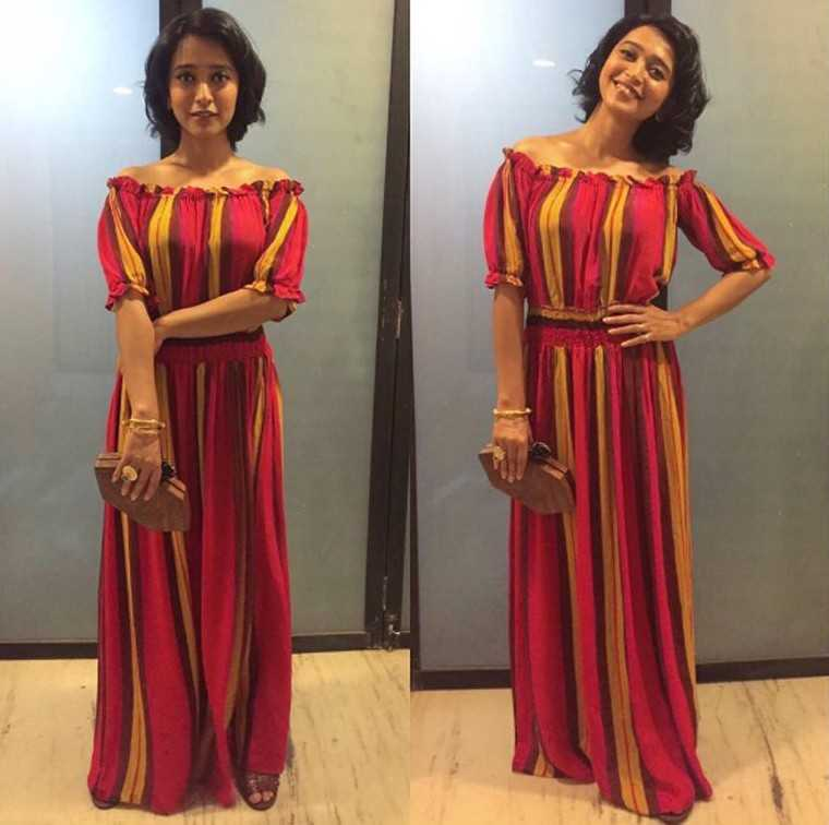 SAYANI GUPTA: Circus-stripes look chic rather than cartoonish when they come on as a flowing off-shoulder dress that's cinched at the waist to make sure it doesn't drown the petite Sayani.