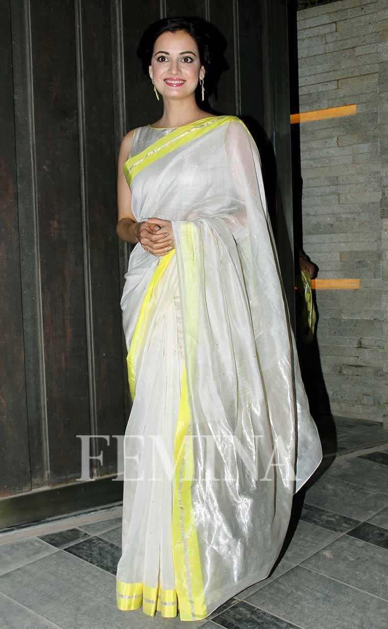 Dia Mirza  signature minimalist style in a gorgeous Raw Mango sari