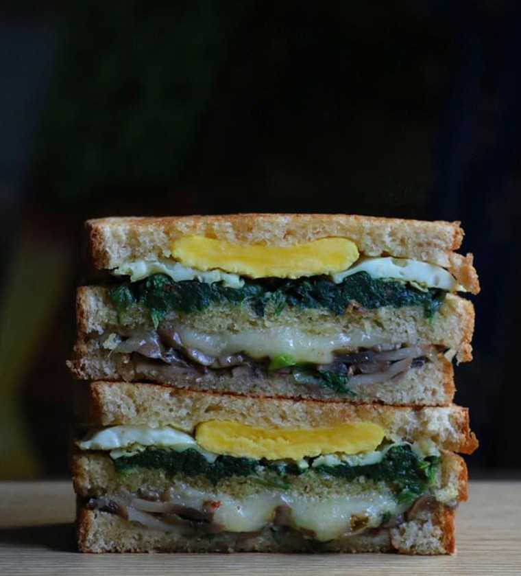 Spinach, egg and mushroom cheese grilled sandwich