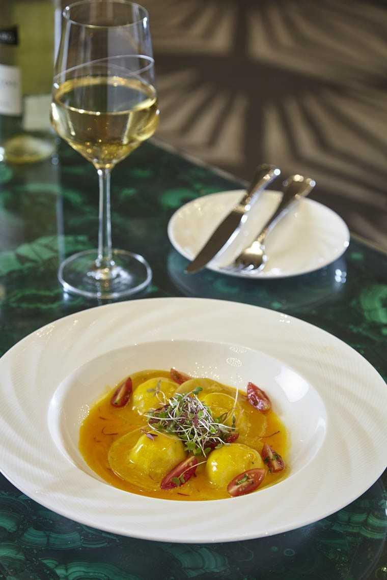 Spinach and ricotta ravioli with tomato salsa, saffron butter