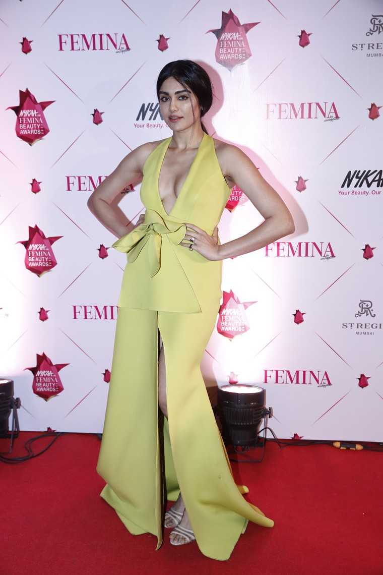Adah Sharma's coral pout was the perfectly contrasting her gown