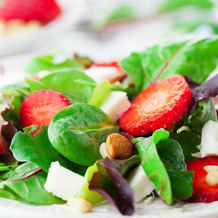 Strawberry rocket leaves salad