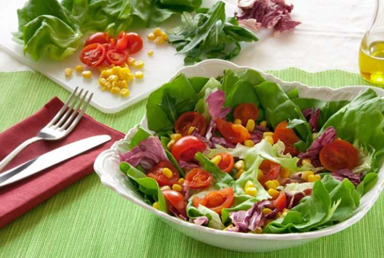 Fresh lettuce, boiled sweet corn and tomato salad