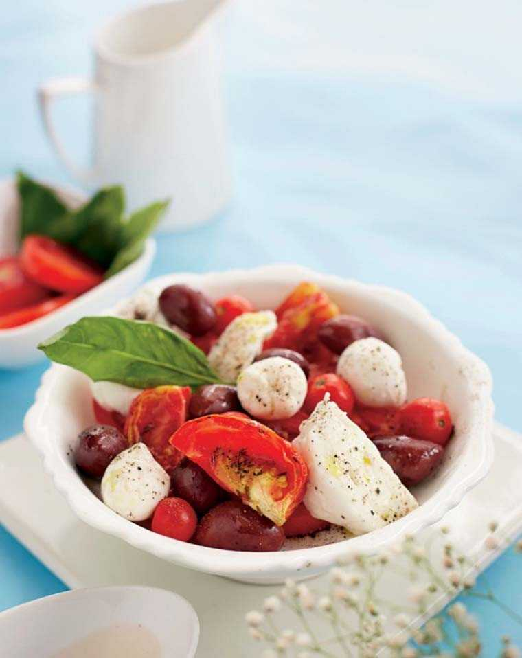 Italian Caprese with ripe tomatoes and fresh Mozzarella