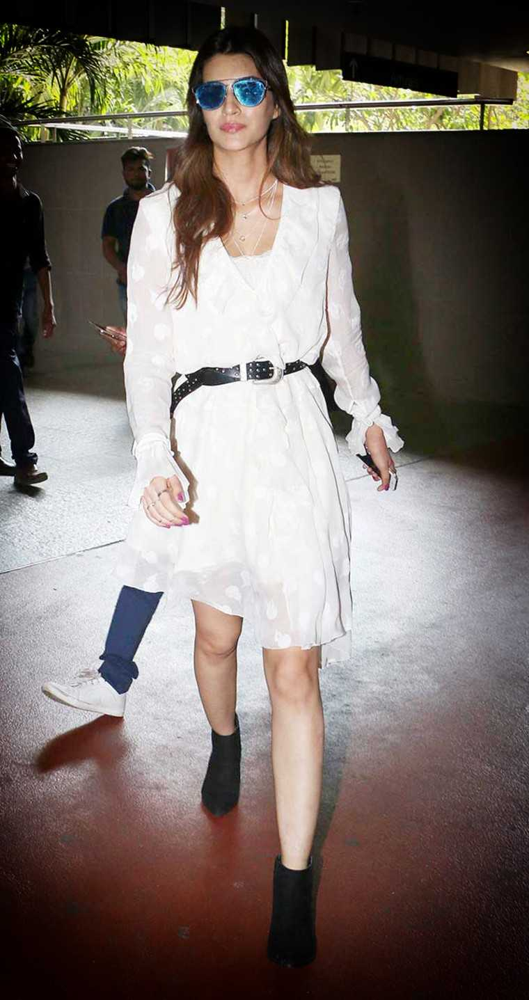 H&M dress belted at the waist and teams it with a pair of ankle boots