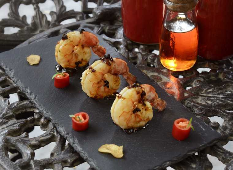 Schezwan pepper & maple glazed prawns