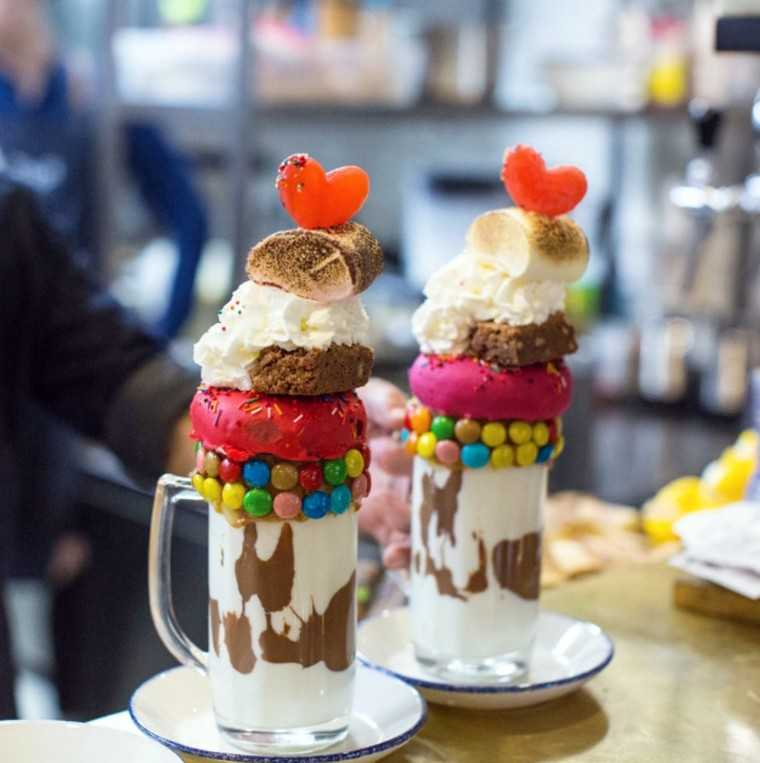 Doughnuts, ice cream and cake on shake by @sos.cafe