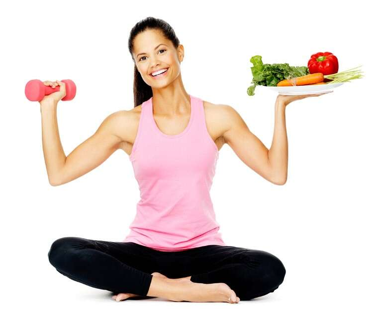 woman with dumbelle and vegetable