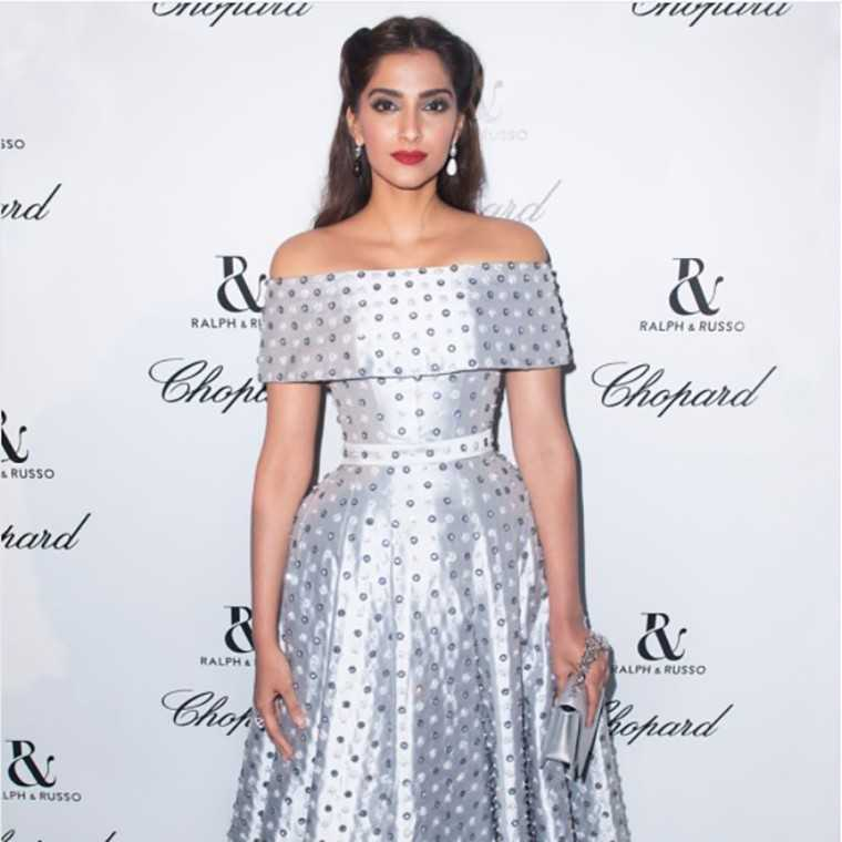 Sonam glimmered in an off-shoulder silver dress