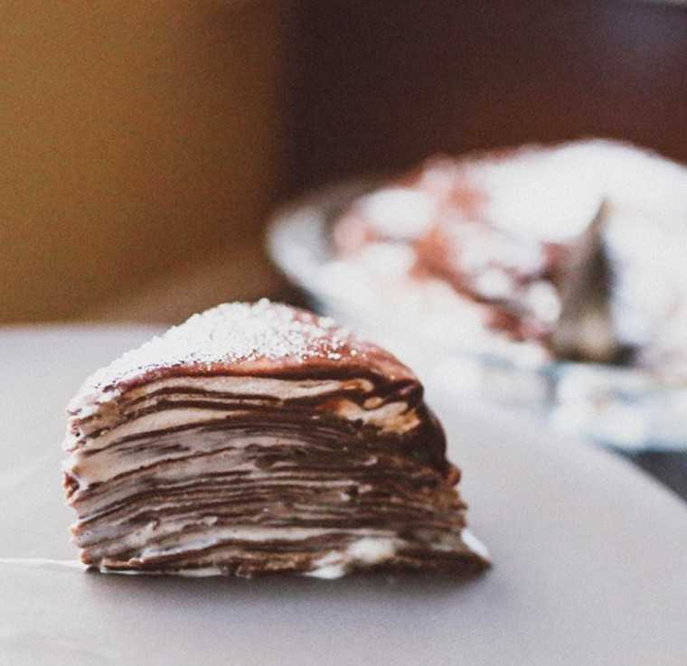 Chocolate crepe cake with whipped cream layers by @crumbld